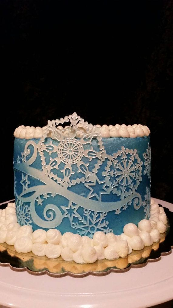 Crystal is a silicone Cake Lace Mat by Claire Bowman that produces various snowflakes designs linked together by swirling branches. This will make the perfect addition to winter wedding cakes; use the snowflakes on cupcakes or cookies. To use the Crystal Lace Mat simply prepare your