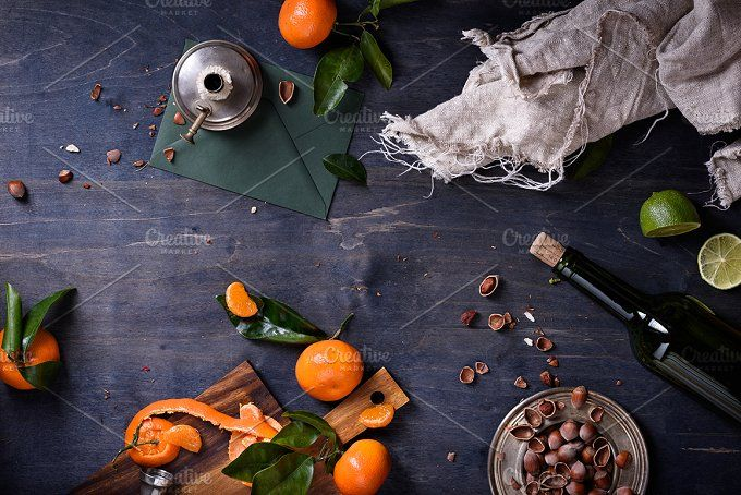 Oranges with leaves, hazelnuts, wine by Iuliia Leonova on @creativemarket