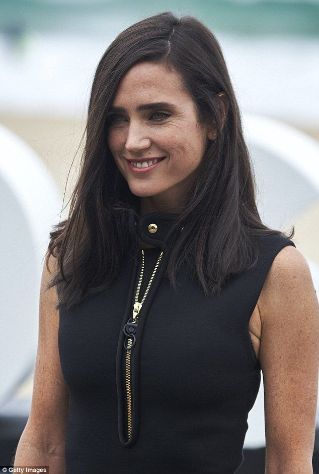 Beautiful: Styling her raven-coloured locks into a side parting,the Oscar-winning actress...