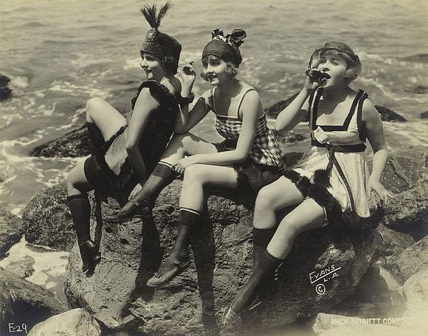 Some fun-looking flappers frolicking at the seaside. I bet they'd be a great group to hang out with!