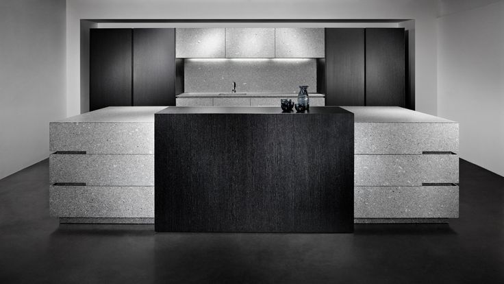 eggersmann Island block, base and wall units in Lupus Grey granite,   tall cabinets and bar counter in Fineline veneer black with breight veins.