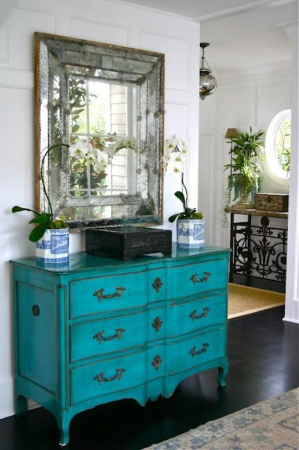 Restyle that tired piece of furniture - paint and distress in a fun   contemporary color.  I swoon over this shade of turquoise.