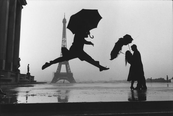 "That's Paris at it's best! Love the couple in the background and the Eiffel Tower. Elliott Erwitt shot this picture as an homage to Bresson's famous ""decisive moment"""