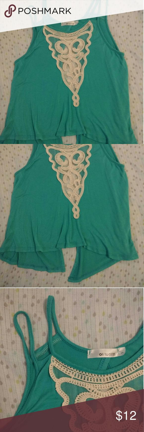 Teal tank top Very cute real tank top with lace accented see through front. And a slit up the whole back side. Like new condition! on twelfth Tops Tank Tops