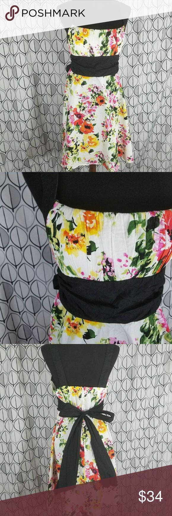 """B. Smart  White Spring Floral Tie waist SunDress B. SMART Dress with Black straps and Empire waist tie back. Gathered square bustline. With prettt floral pattern okn a white background.  Pink yellow red orage flowers with green leaves. Hidden zippered center back. Size 16 measurements laying flat are approximate bust 19"""" has some stretch waist 17"""" length armpit to hem 26"""" fun Spring Summer dress for weddings and graduations.  Semi casual.dress for Tea and fun summer days and nights. Get in…"""