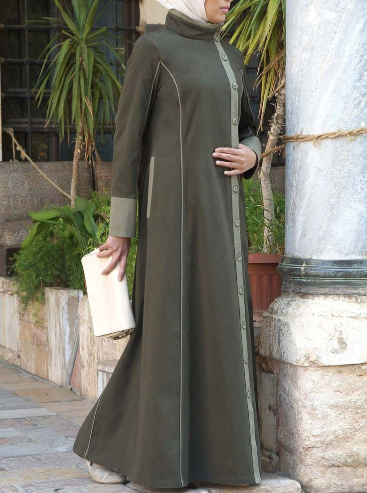 We can't get enough of this modern take on the traditional jilbab. Its deep colors and bold detailing create eye-catching balance and a striking contrast. Designed with a flattering cut and coloring and contemporary style elements, this piece is a welcome update to your current jilbab collection.