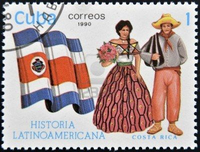 CUBA - CIRCA 1990: Un sello impreso en Cuba dedicada a la historia de América Latina, muestra trajes típicos y la bandera de Costa Rica, alr...