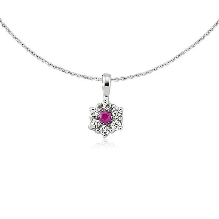 Din aur alb si diamante dispuse in floare, pandantivul LDN0144 cucereste prin rubinul central roz -> http://www.bijuteriilarosa.ro/bijuterii-cu-diamant/pandantive/pandantiv-ldn0144