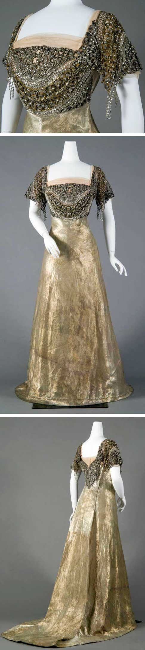 Evening dress, Reville & Rossiter, Ltd., London, ca. 1910. Twilled silver cloth. Square neck and short sleeves. Bodice trimmed with silver bugle beads, seed beads, & rhinestones. Draped light pink tulle at neck & sleeves. Bodice lined with white chiffon and satin; steel stays in built-in corset. Floor-length skirt with slight train. Metal weights in skirt and throughout bottom hem. Chicago History Museum