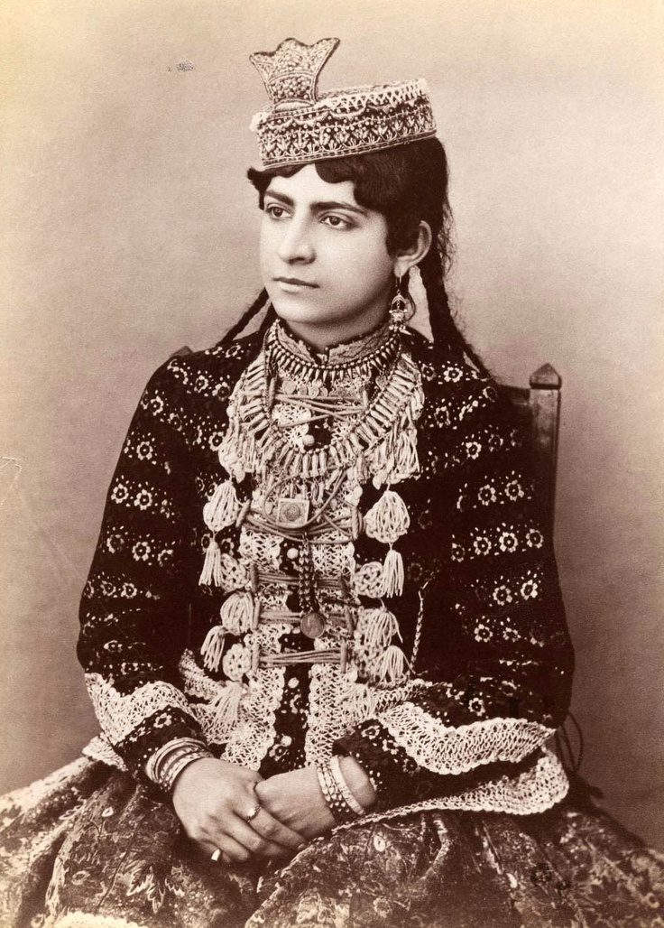 Iran (Persia)   Young girl in urban dress, featuring hat with crown ornament   ca. Late 19th to early 20th century   Qajar Dynasty