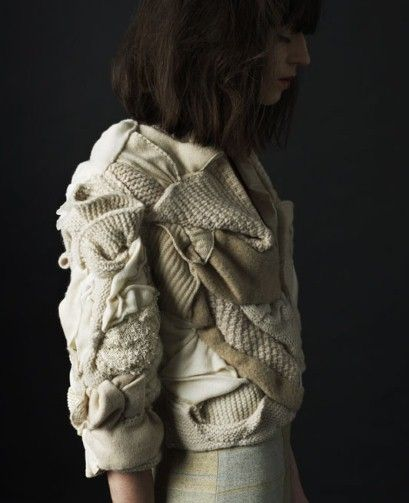 Upcycled fashion—really cool mix of knits pleated and folded together into an intriguingly textured garment.