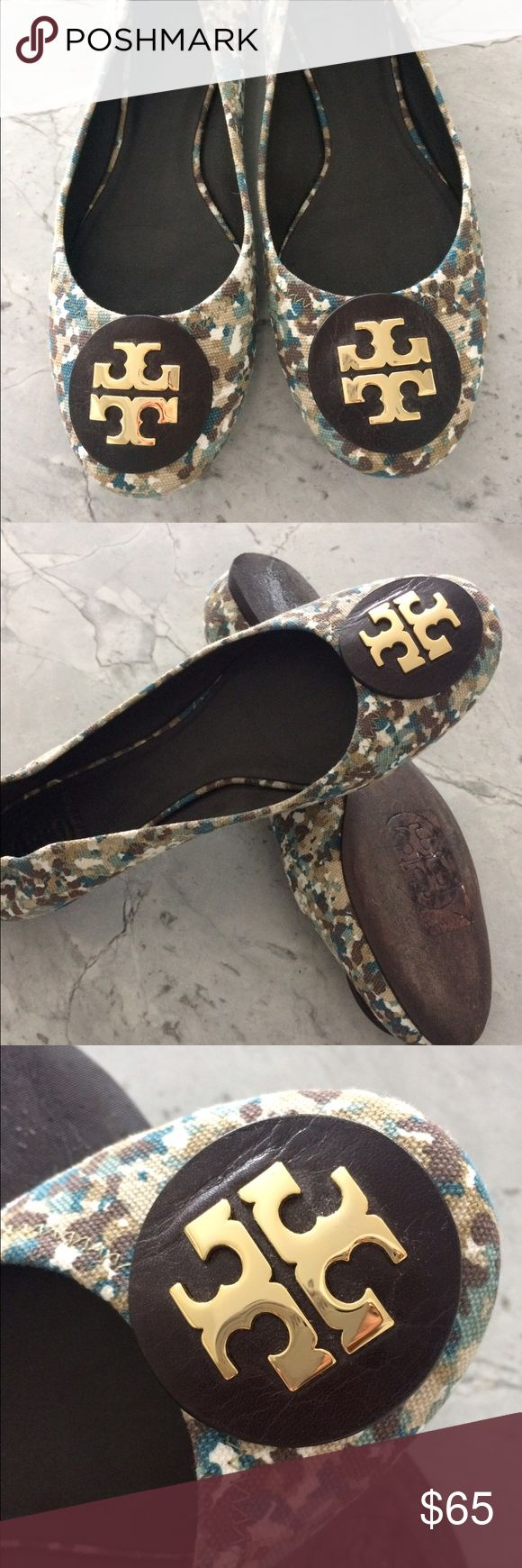 Tory Burch fabric and leather flats Tory Burch fabric and leather flats. Size 9 and 1/2. I can wear 9 or 9.5 in these flats. These are loved worn bottom but the top looks pretty good condition.  If you're looking for perfect TB flats these are not them but they look oh so cute when they are on. Leather sole and leather circle with gold Tory symbol in the middle. Lots of compliments. I purchased these at the Nord Rack. Tory Burch Shoes Flats & Loafers