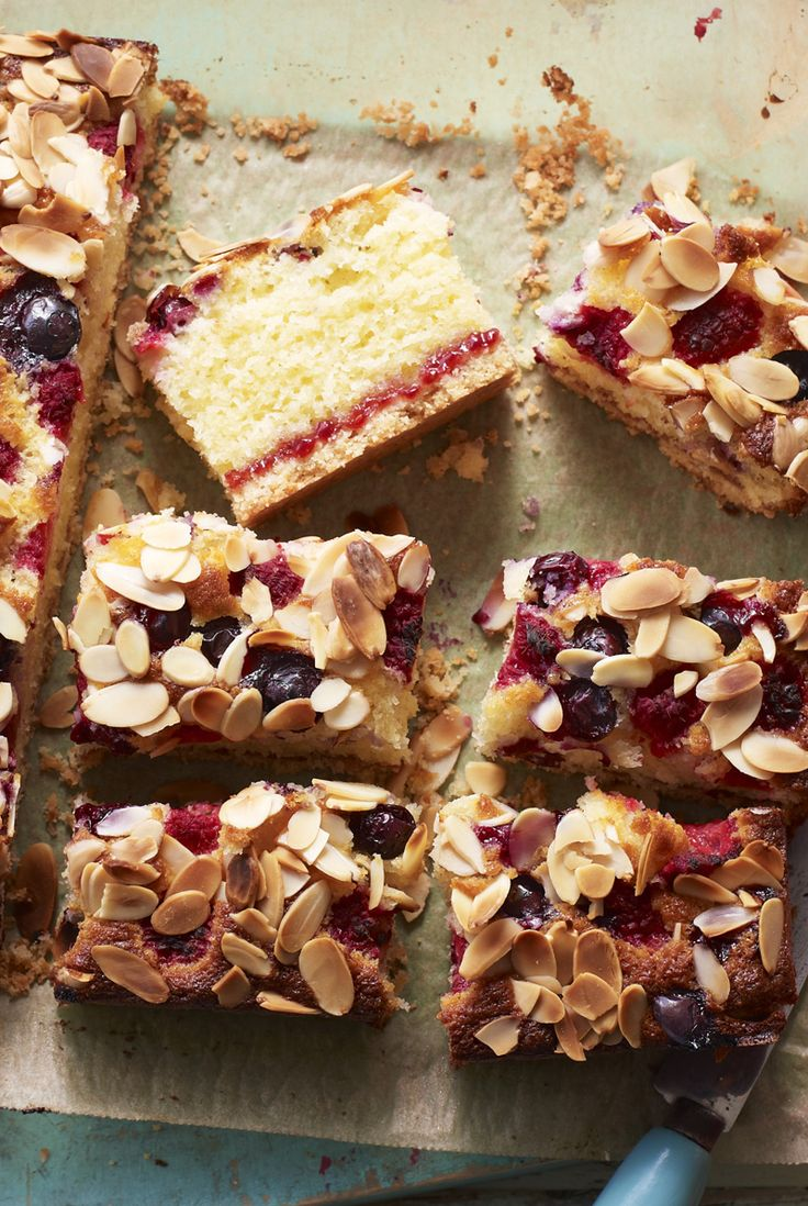 Blueberry and raspberry almond cake with a hidden layer of jam and a buttery biscuit base.