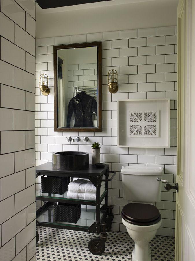 Large subway tile, dark grout, black toilet seat, wall-mounted taps... (Hubert Zandberg Interiors | Notting Hill Townhouse)