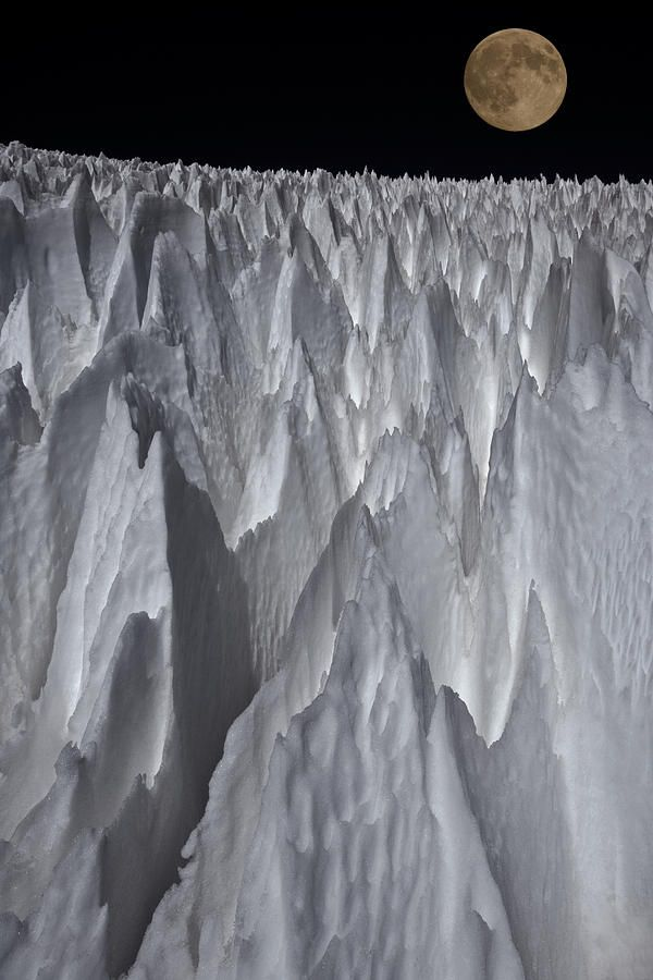 Los Penitentes - With Full Moon -  Argentina. Penitentes, are a snow formation found at high altitudes. They take the form of tall thin blades of hardened snow or ice, closely spaced with the blades oriented towards the general direction of the sun.