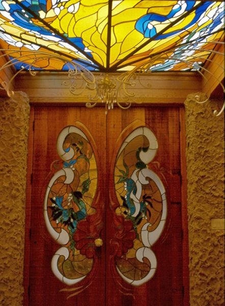 Stained glass skylight and door by James Hubbell.