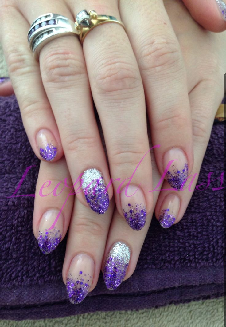 Acrylic nails with purple glitter fade and silver to purple glitter ombré feature nail.