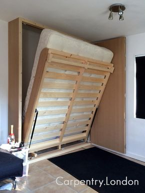Fold-down space-saving wall bed. Uncomfortable beds are terrible. You may not think you have space for a large bed, but check out this well-designed bed built by Carpentry.London. It features a king size mattress and is made for everyday use. When folded up it takes minimal floor space and can be folded down in less then a minute. | Tiny Homes
