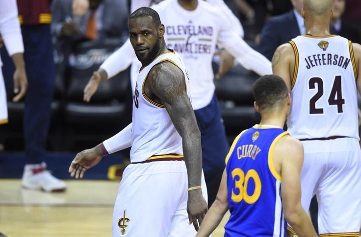Jun 16, 2016; Cleveland, OH, USA; Cleveland Cavaliers forward LeBron James (23) stares at Golden State Warriors guard Stephen Curry (30) in the fourth quarter in game six of the NBA Finals at Quicken Loans Arena. Cleveland won 115-101. Mandatory Credit: David Richard-USA TODAY Sports