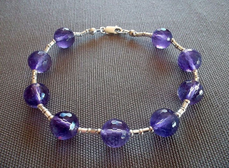 Handcrafted bracelet featuring 10mm faceted genuine amethyst beads and sterling silver beads and clasp. 8 inches in length.