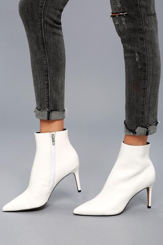 Get your power strut on in the Steven by Steve Madden Logic White Leather  Ankle Booties! Luxe, genuine leather sweeps over the pointed toe upper and  rises ...