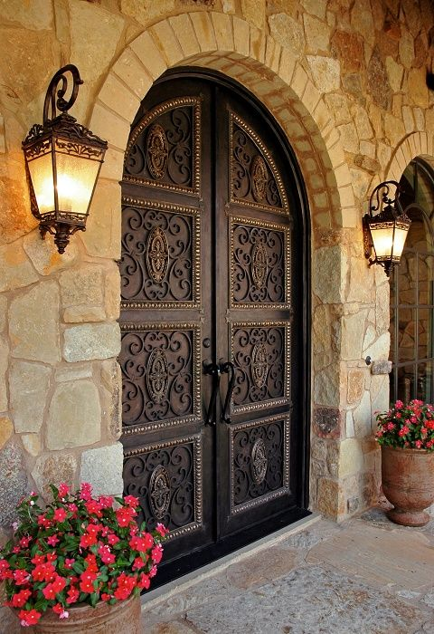 This door is awesome..  More than we need or want to spend I'm sure.   beautiful!!  DOORS arch with Tuscan lighting, love it