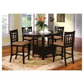 """Furniture of America Hoseah 5 Piece Expandable Counter Height Dining Set in Espresso is complete with 4 chairs and an expandable table with included 18"""" leaf. Padded in soft fabric upholstery with a fenced back design, the counter height chairs include an attached footrest for your convenience. A transitional design, this oval-top table features a center display shelf for readily storing useful dining items such as dinnerware or serveware. The Furniture of America Hoseah 5 Piece Exp..."""