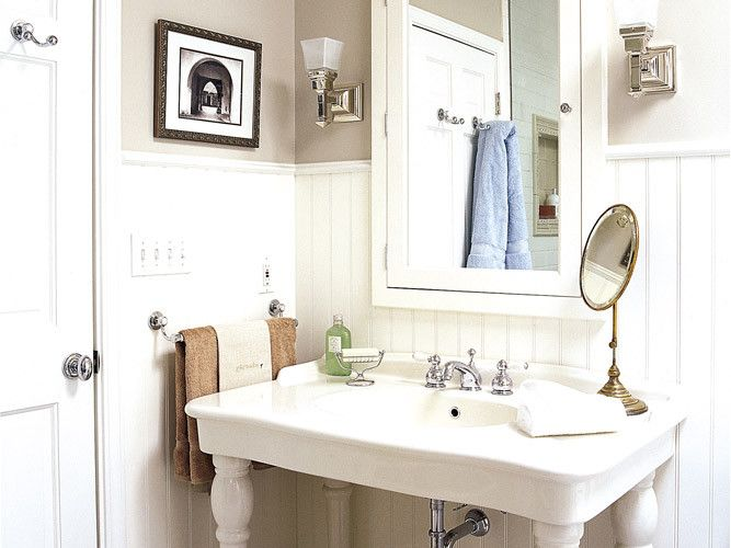 Vintage-inspired fixtures, traditional sconces and a classic medicine cabinet reinforce the pre-war look. Photo: Casey Sills. thisoldhouse.com