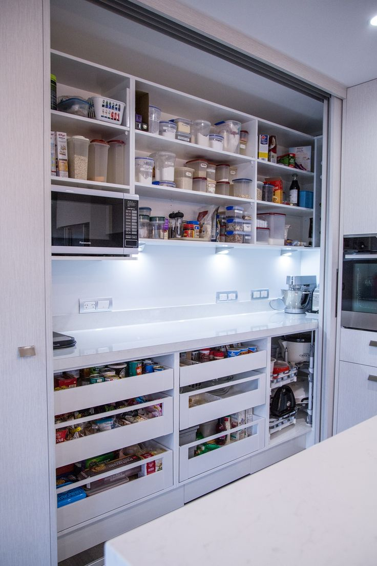 Hidden pantry featuring Formica Pure Marble