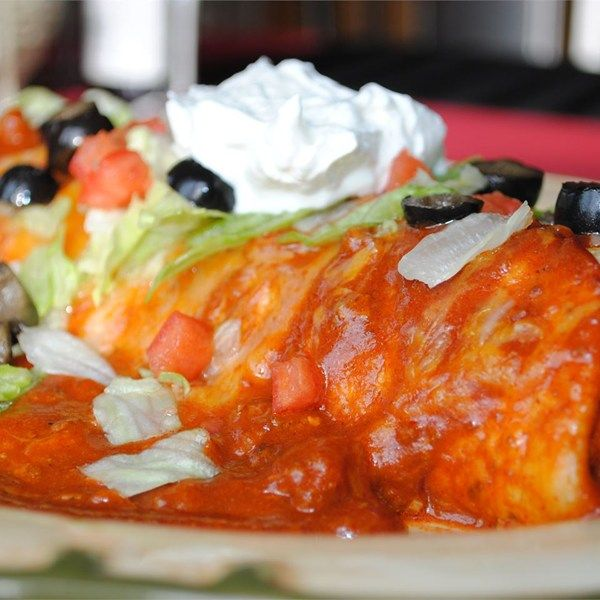 "Fabulous Wet Burritos | ""We made these exactly per the recipe. They were better than our local Mexican-style restaurant. They make great leftovers since you make the burritos as you go. The only change I would make would be to put the cheese inside of the burrito, since it slips off with all of the sauce. Thanks for the recipe!"""