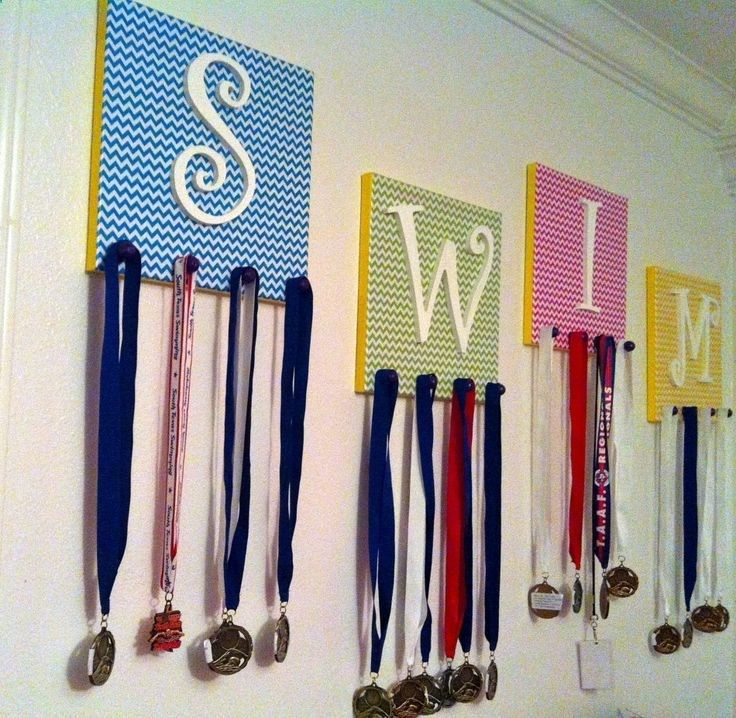 DIY Swim Medal and Accessory Holder - Easy and creative way to display your kids medals or accessories (i.e. jewelry, hair ribbons, etc). Works for any sport or competition. Technique is easily adaptable to make a simple holiday or general wall art.