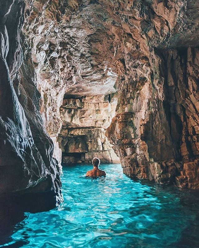 Swimming through the blue caves of Istra, Croatia| Photography by @doyoutravel