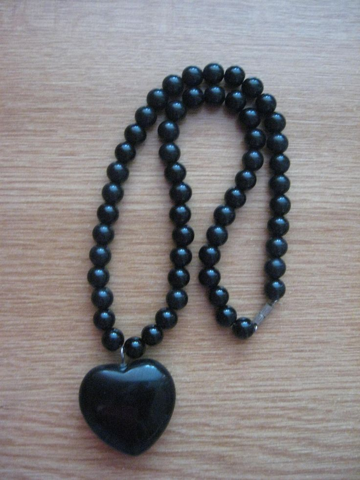 black heart and black beads. always found it morbid