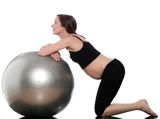 Using your birth ball and a hands and knees position can really help with back labor.