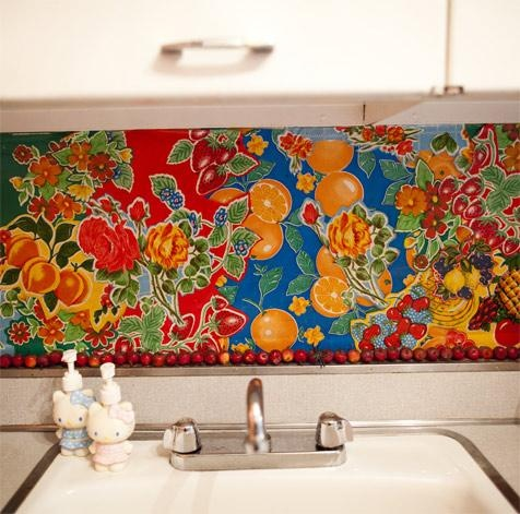 cut up old vinyl tablecloth to use as a backsplash in a rental. Really tempted to try this