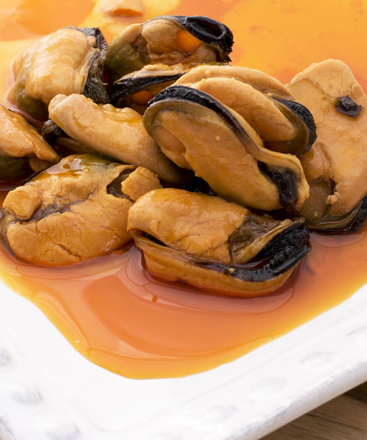 Mussels in Escabeche, or pickled sauce, from the waters of Galicia. Spanish canned seafood is unique, using top quality raw ingredients to preserve and heighten flavors of the sea. Mussels like these are often served straight from the tin, in tapas bars and at home.
