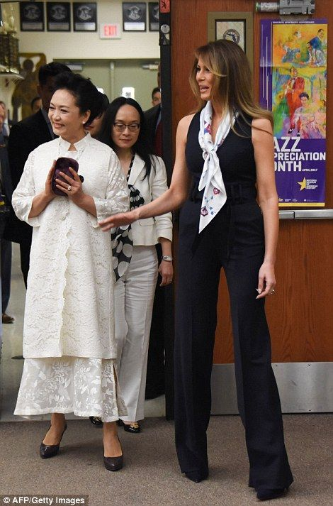 First Lady Melania Trump and Peng Liyuan, the wife of Chinese President Xi Jinping, spent Friday afternoon visiting a seventh grade civics class in West Palm Beach, Florida.