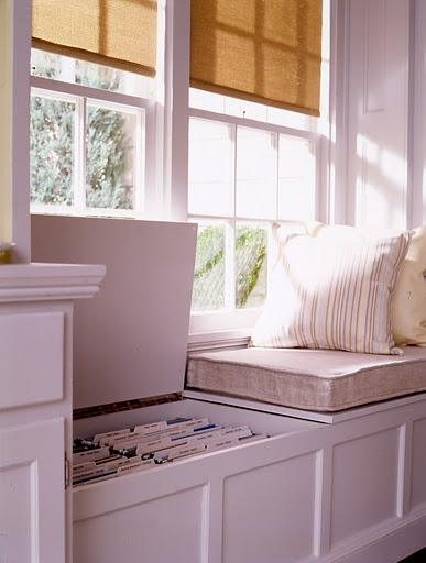 File built into window seat bench.  I'v also seen it built where the files slide out so you don't have to lift the top.