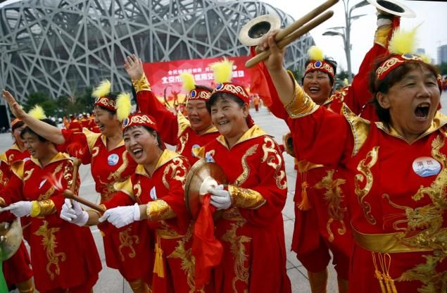 Beijing selected to host 2022 Winter Olympics.  Performers outside the Birds' Nest, also known as the National Stadium, in Beijing rejoice!