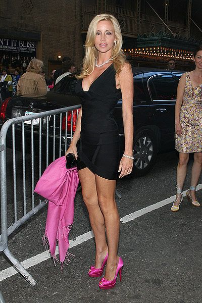 Camille Grammer working the black dress and hot pink heels ...