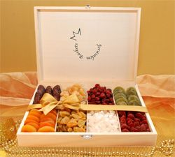 This lavish wooden box opens to reveal a rainbow of colors, tastes and textures from Israel, making it a unique Purim gift. Featuring a mouthwatering assortment of Israel's finest kosher dried fruit, this box is sure to crown the Purim feast. From the dates and raisins traditionally associated with Israel, and classic favorites such as apricots, ginger and cranberries, to exotic dried kiwi, strawberries and coconut, this selection makes an elegant and healthy mishloach manot.