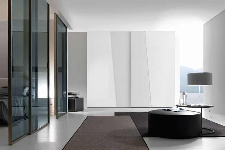Wardrobe with gloss lacquered and bianco candido color wood Diagonal sliding doors and chromed concealed handles.__ Armadio con anta scorrevole Diagonal laccato lucido e color wood bianco candido, maniglia a scomparsa cromata.