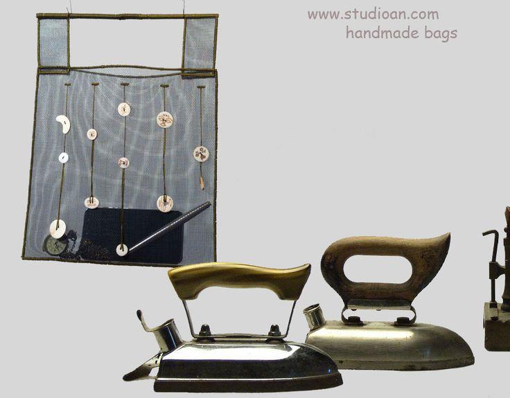 Soft screen handbag with buttons made of wood #studioAN #handbags #transparentbags #handmade http://www.studioan.com/ngine/en/product/77/soft-screen-handbag-with-buttons-made-of-wood