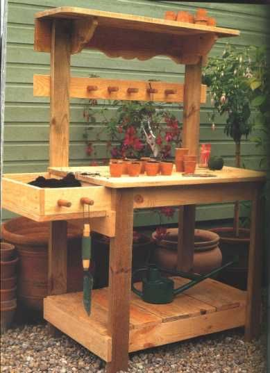Garden work bench ideas.  Like the over hang lip that would allow for knobs to hang things on with out you running into them all the time.  The side dirt box might be nice if it is removable...maybe just have a soil island on wheels so I could roll it to wherever I needed it (such as over to the car so I wouldn't have to carry soil bags so far).