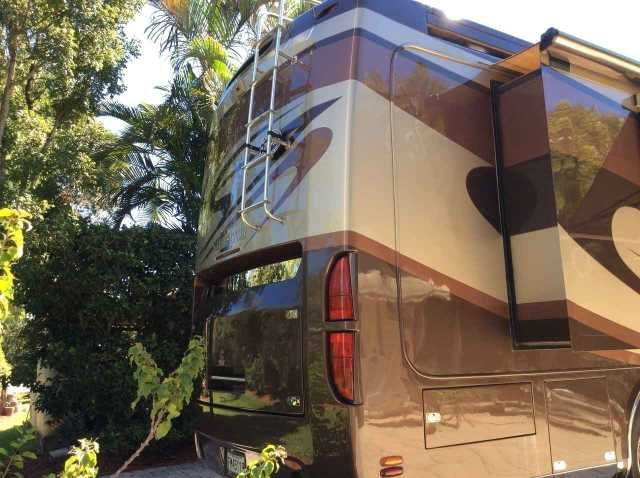 2007 Used Holiday Rambler Navigator 45PBQ Class A in Florida FL.Recreational Vehicle, rv, 4 slides with new over slide canvas - Coach never used in rental- No pets Non smokers 8 new MichelinTires- 10 new batteries - No sees deluxe tire leather covers- All around stainless steel 10 inch. Executive Armour. Aladdin video coach system with see vision security camera. Roof mount electric Girard Awnings. All around windows (6) electric Girard Awning. Driver/passenger/door/windshield exterior…