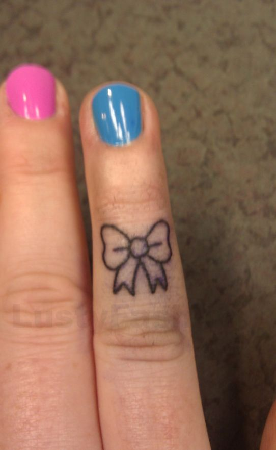 bow finger tattoos 2014