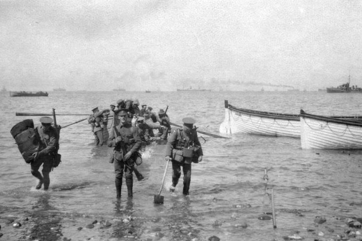 1915: Divisional Headquarters staff wade ashore at Anzac Cove on April 25.