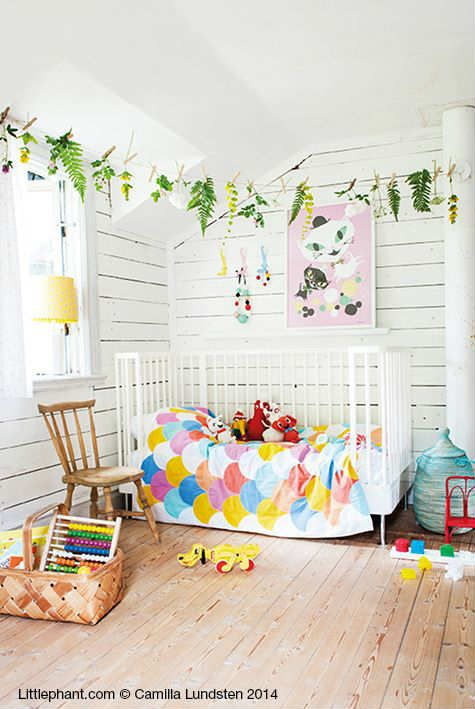 Love the bright colour accents and garland of felt leaves 10 colourful nurseries tinyme
