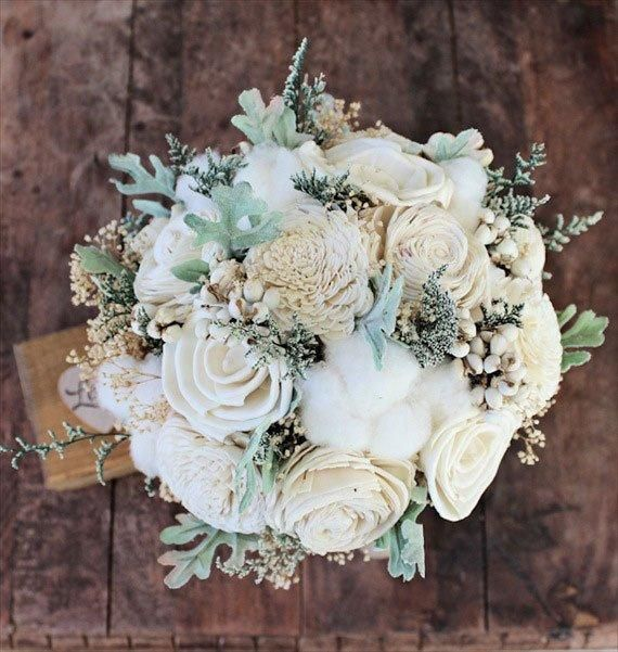 This felted flower bouquet uses frothy cotton to give it a round shape and add to its neutral color palette. Description from weddbook.com. I searched for this on bing.com/images