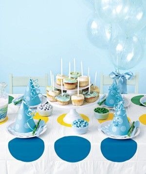 Use a Twister mat as a tablecloth - easy clean-up & love those huge polka dots!!!  Great idea RealSimple.com!